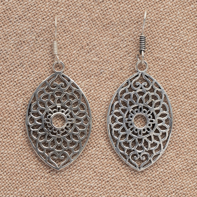 Artisan handmade solid silver, large oval shaped, floral patterned dangle earrings designed by OMishka.