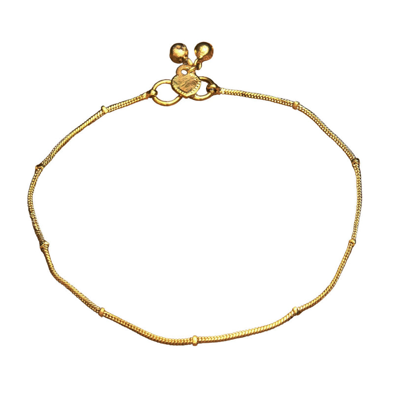 A delicate artisan handmade, pure brass thin ribbed snake chain anklet designed by OMishka.