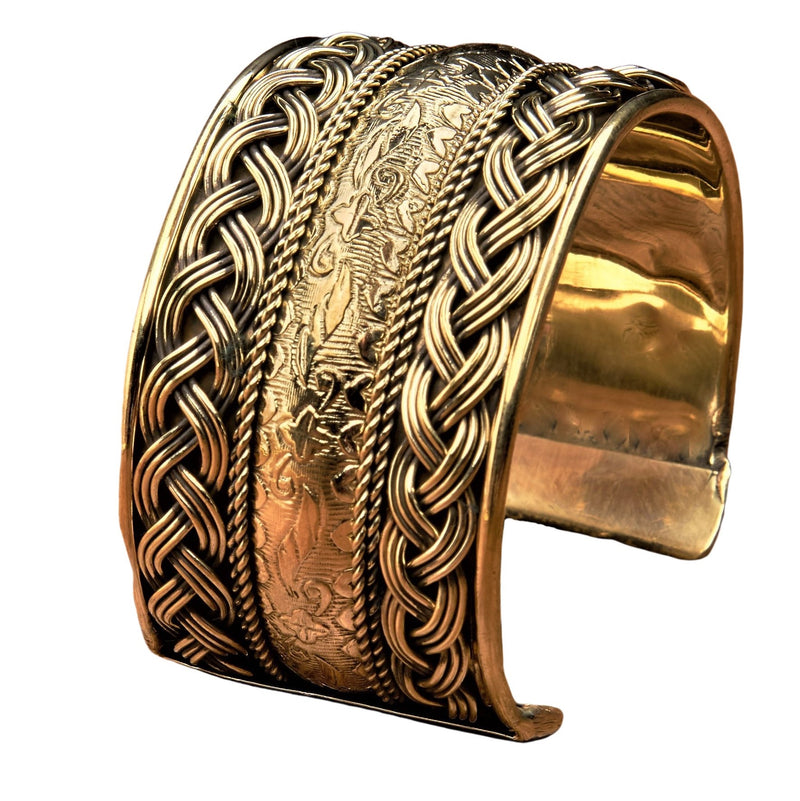 An artisan handmade, wide woven pure brass, floral patterned cuff bracelet designed by OMishka.
