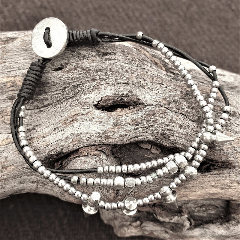 Artisan handmade silver toned, beaded spike charm and black cord dainty bracelet designed by OMishka.