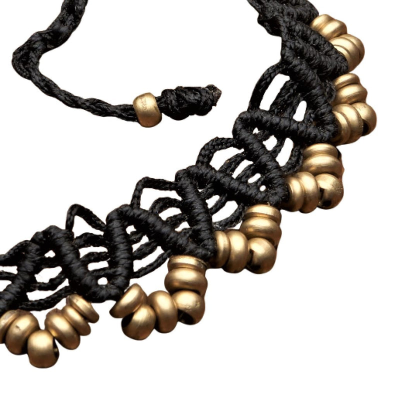 A strong, black macrame weave, pure brass beaded ankle bracelet designed by OMishka.