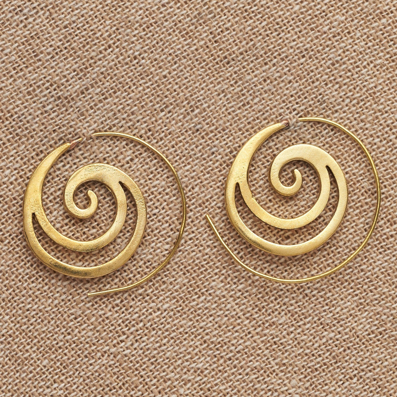 Handmade pure brass, cut out crested wave spiral hoop earrings designed by OMishka.