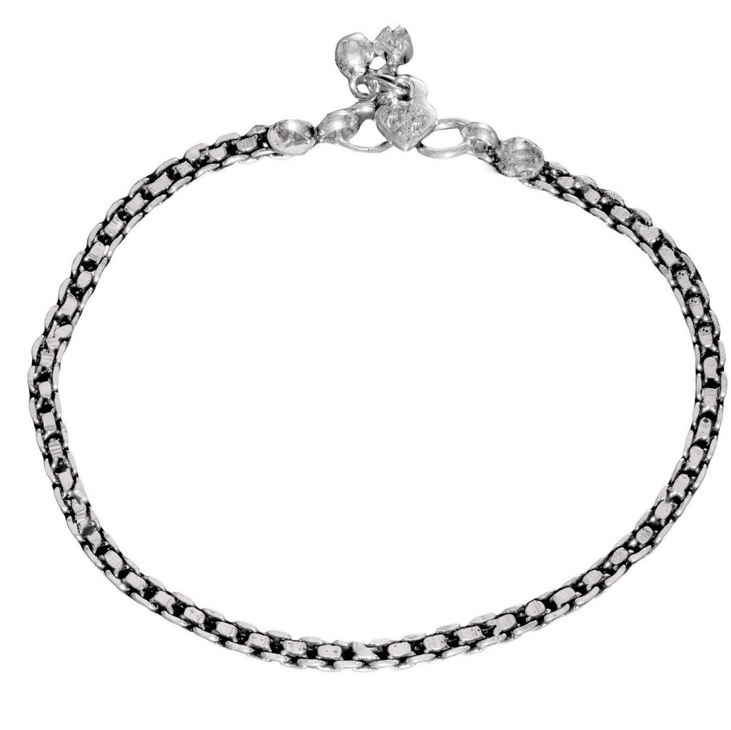 A chunky, nickel free solid silver box chain anklet with tiny bells designed by OMishka.