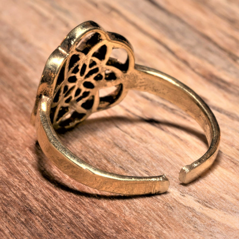 An adjustable, dainty, handmade pure brass seed of life ring designed by OMishka.