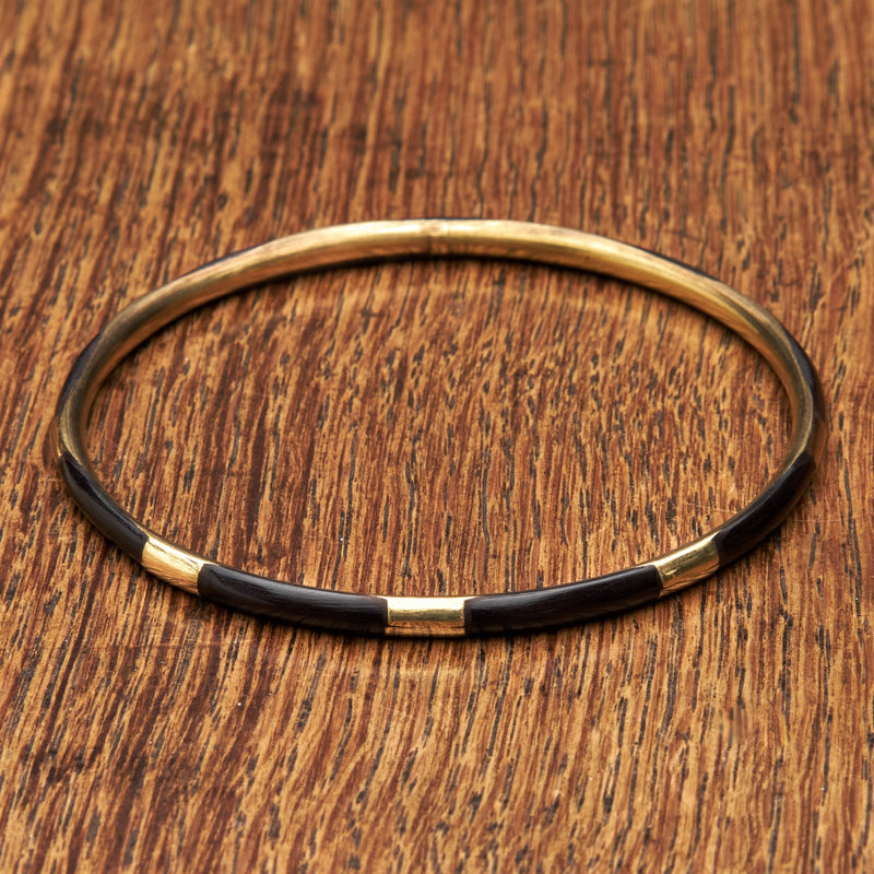 A handmade, pure brass and black enamel striped thin bangle bracelet designed by OMishka.
