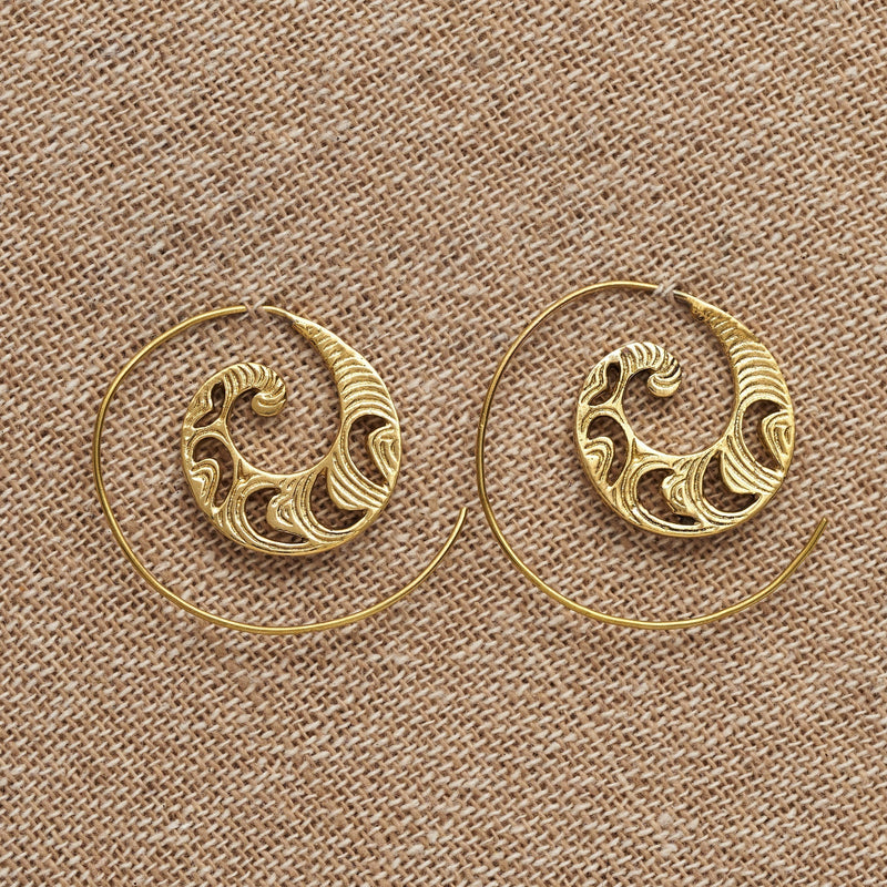 Handmade pure brass, dainty, crescent and swirl patterned spiral hoop earrings designed by OMishka.