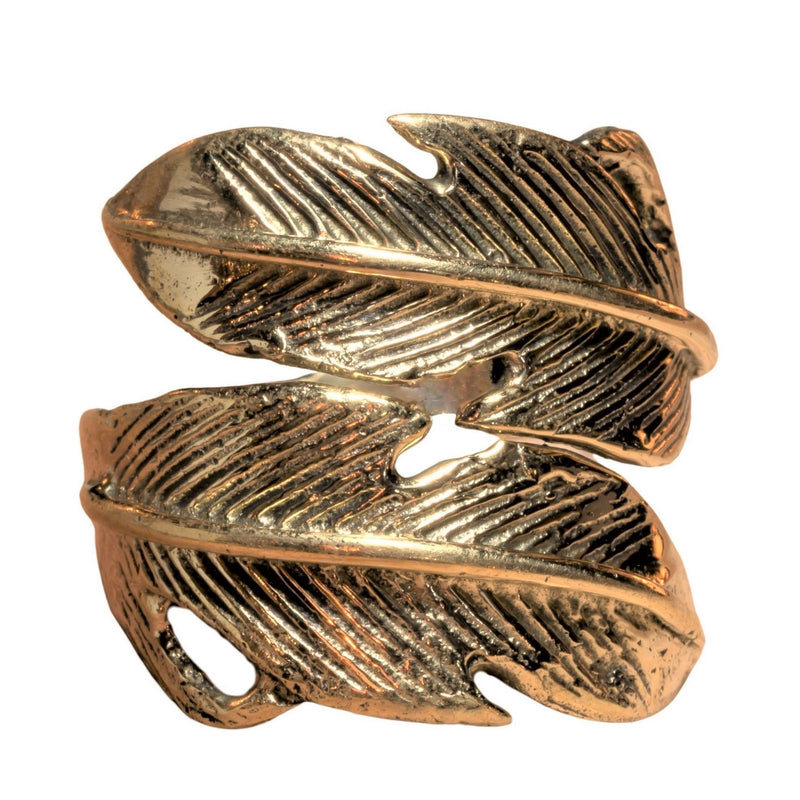 An adjustable, chunky, handmade pure brass, double feather wrap ring designed by OMishka.