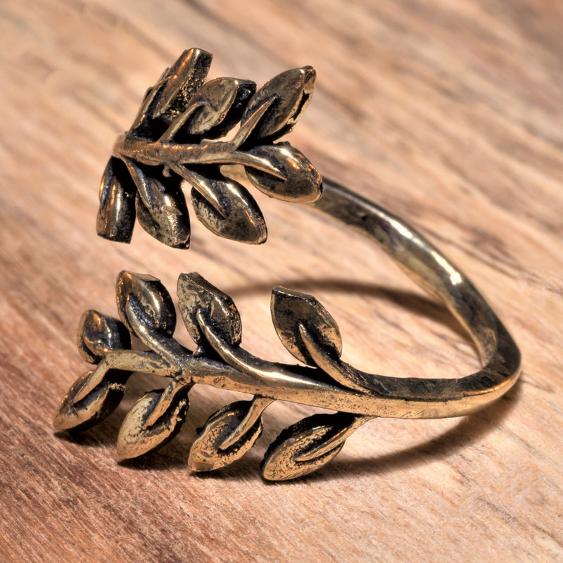An adjustable, handmade pure brass olive branch wrap ring designed by OMishka.
