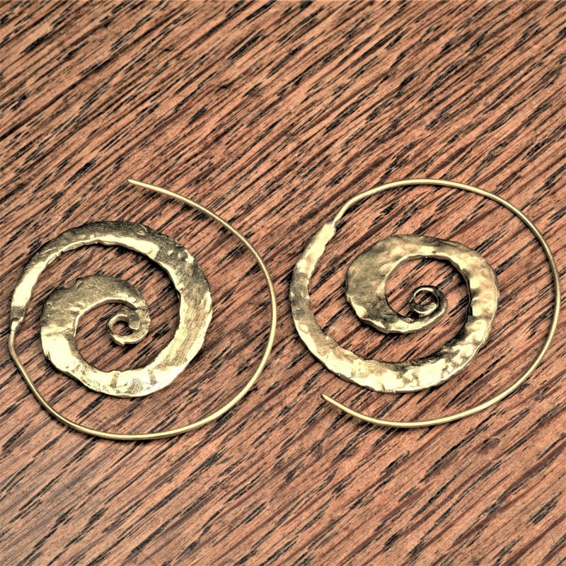 Handmade pure brass, flat, hammered textured spiral hoop earrings designed by OMishka.