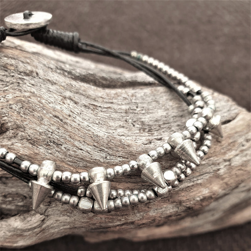 Handmade silver toned, beaded spike charm and black cord dainty bracelet designed by OMishka.