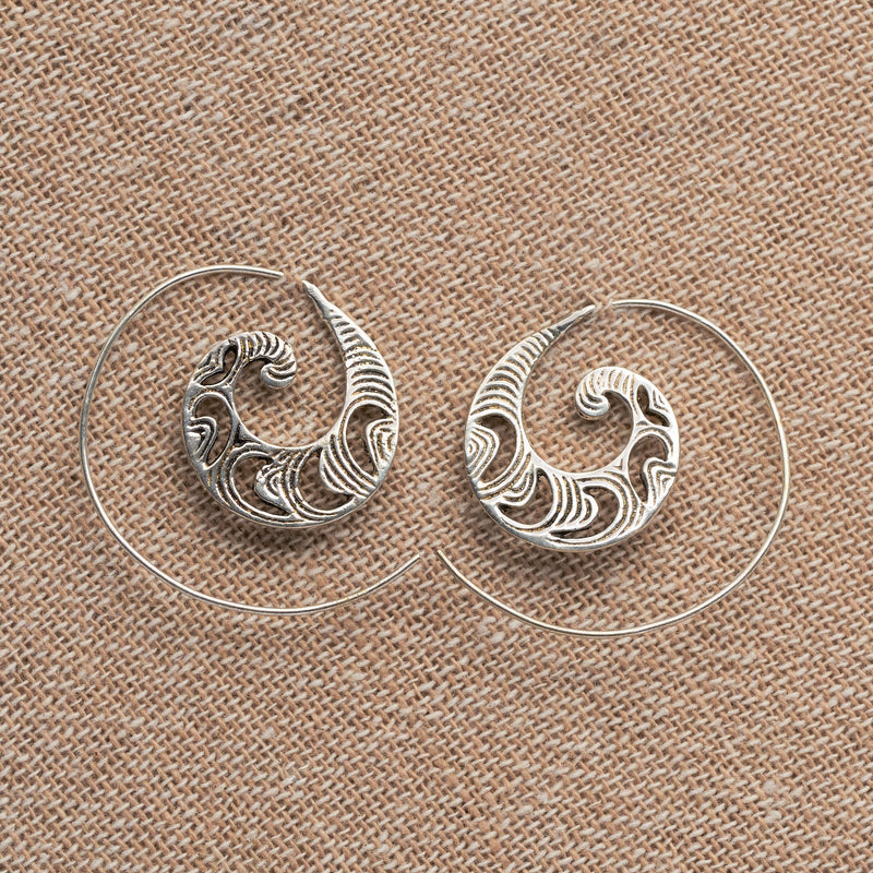 Handmade solid silver, dainty, crescent and swirl patterned spiral hoop earrings designed by OMishka.