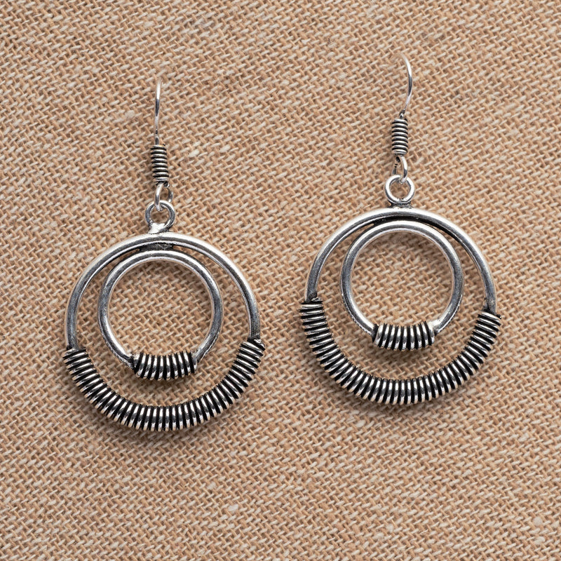 Artisan handmade solid silver, double nested hoop with a coiled detail, dangle earrings designed by OMishka.