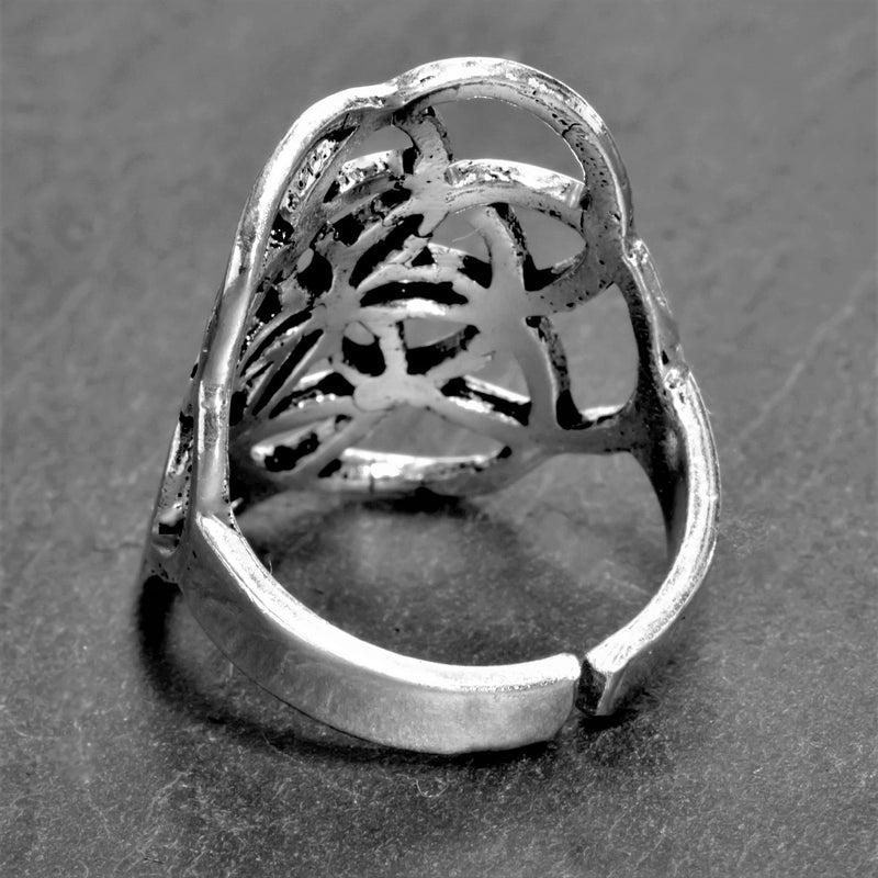 A large, handmade, adjustable solid silver seed of life ring designed by OMishka.