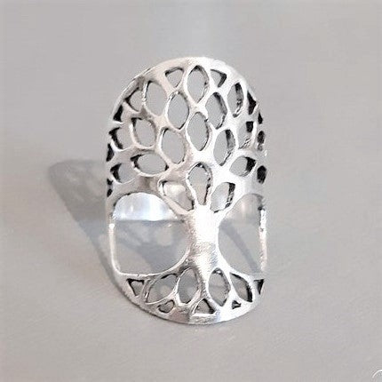 A long and chunky, adjustable, nickel free solid silver, tree of life ring designed by OMishka.