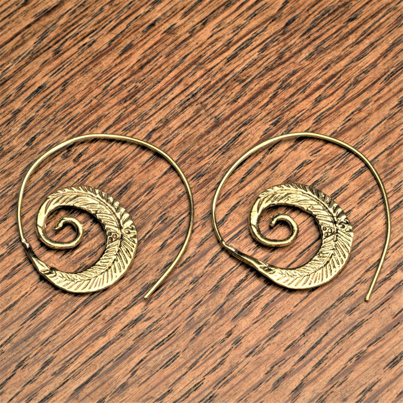 Handmade nickel free pure brass, feather spiral hoop earrings designed by OMishka.