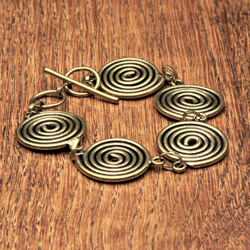 Handmade nickel free pure brass, five spiral detail, smooth textured bracelet designed by OMishka.