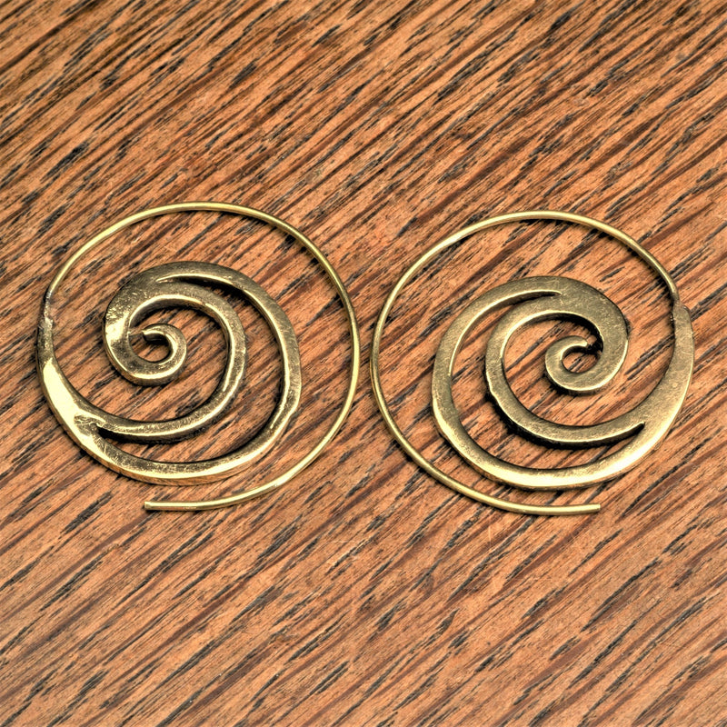 Handmade nickel free pure brass, cut out crested wave spiral hoop earrings designed by OMishka.
