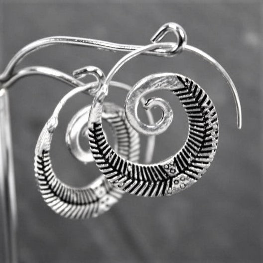 Handmade nickel free solid silver, feather detailed, spiral hoop earrings designed by OMishka.