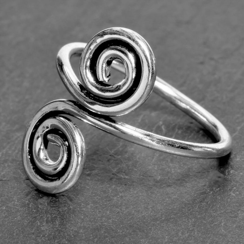 An adjustable, nickel free solid silver, double spiral wrap ring designed by OMishka.