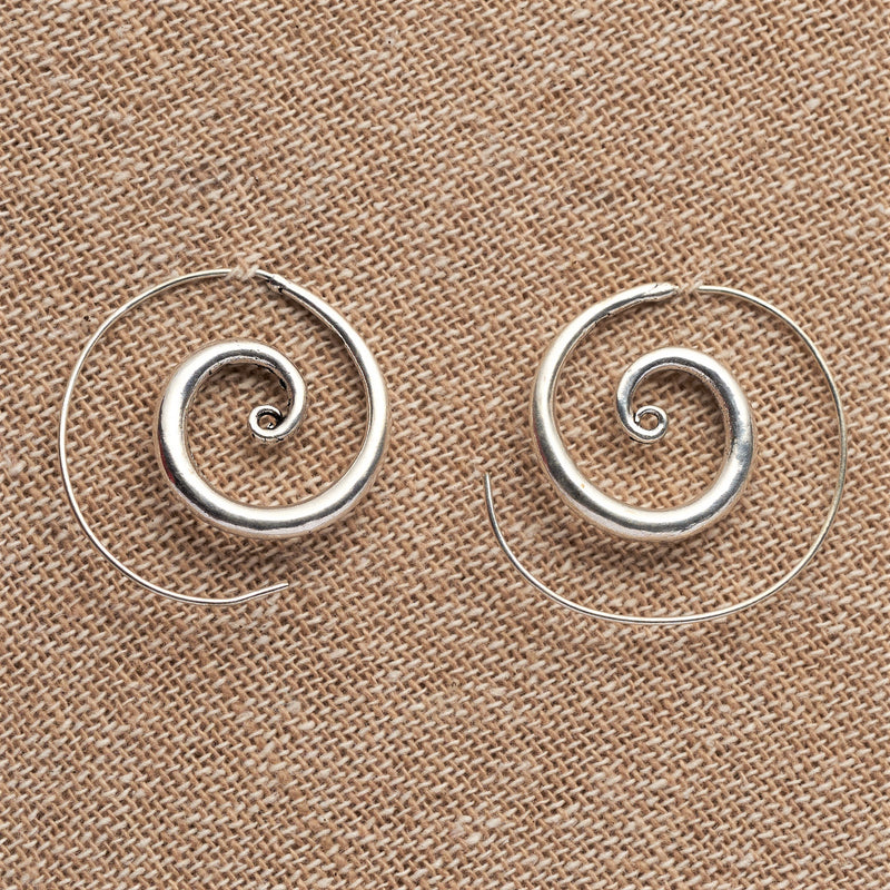 Handmade, nickel free solid silver, thickening shaped spiral hoop earrings designed by OMishka.
