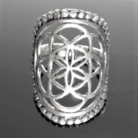 An adjustable, large, solid silver decorative beaded seed of life ring designed by OMishka.