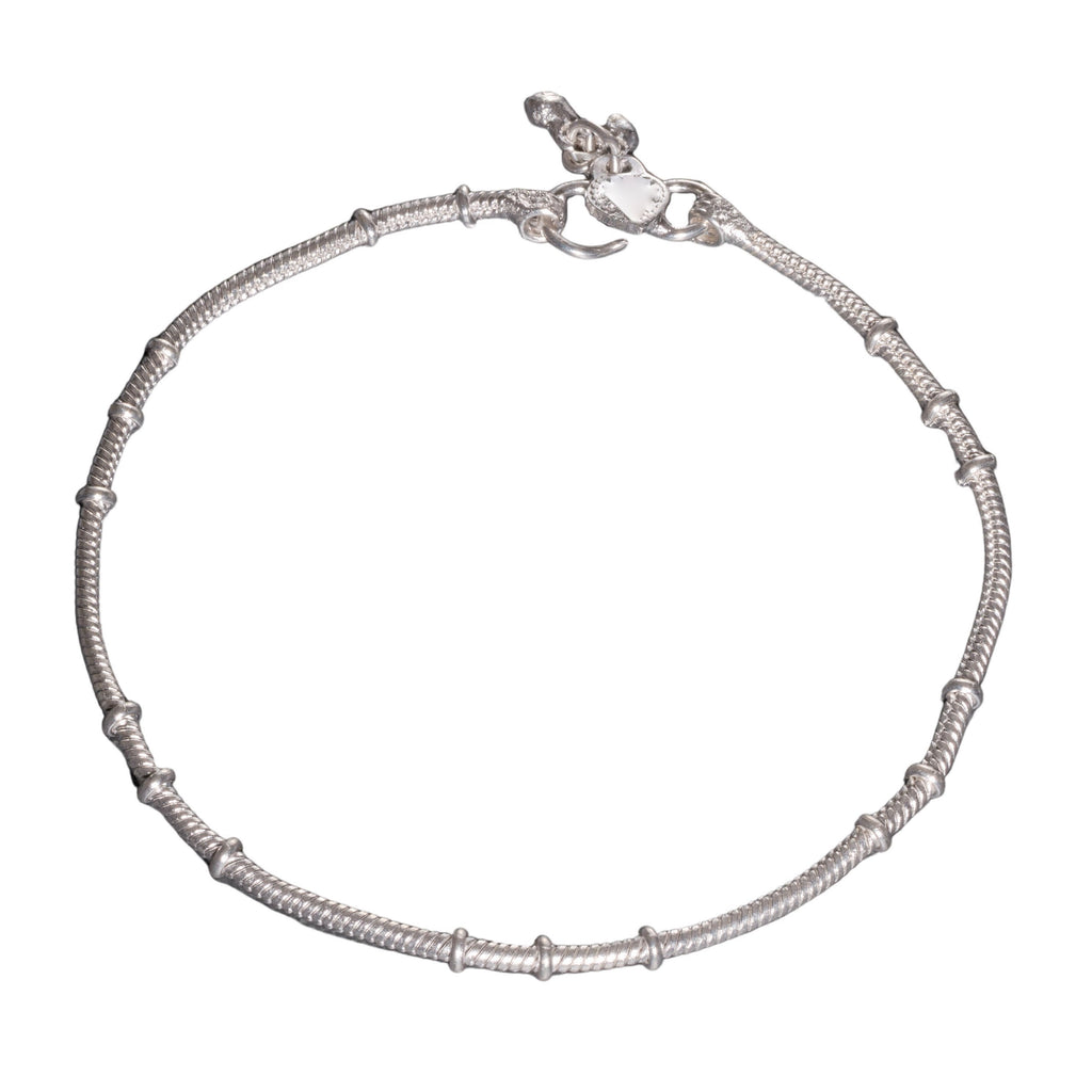 A thin, nickel free solid silver ankle chain with tiny bells designed by OMishka.