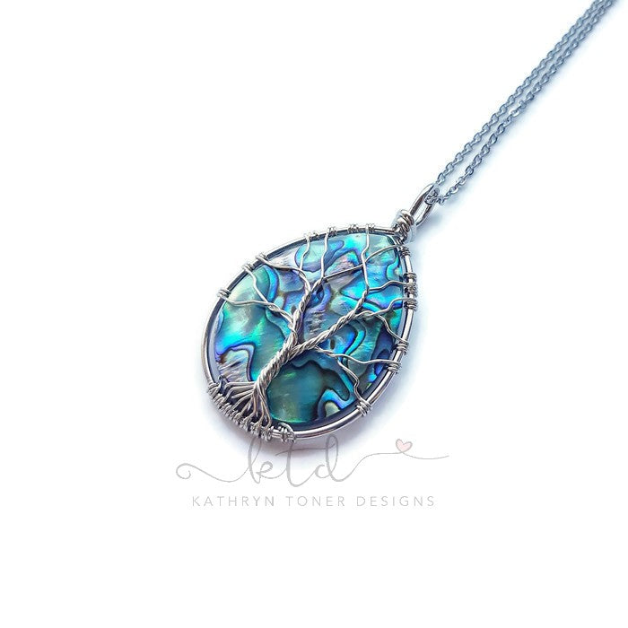 Abalone shell wire wrapped tree of life necklace.