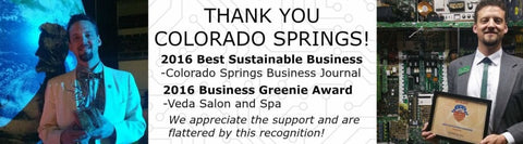 Drew is holding the 2016 business Greenie award and the 2016 best sustainable business award.