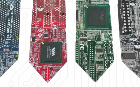 the (*edit* almost) complete history of circuit board ties drewa line up of ties made from mother boards of varying colours blue on the