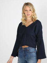 Navy cropped sweater on model 6