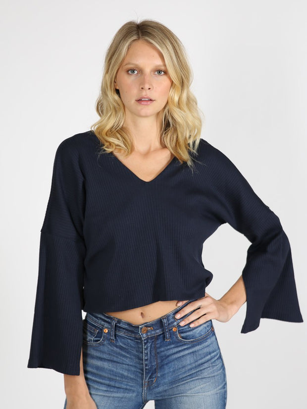 Navy cropped sweater on model 5