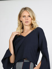 Navy cropped sweater on model 1