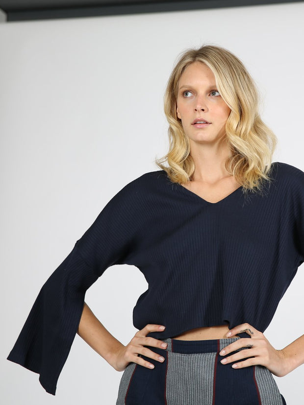 Navy cropped sweater on model 4