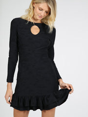 Black ruffle dress on model 9