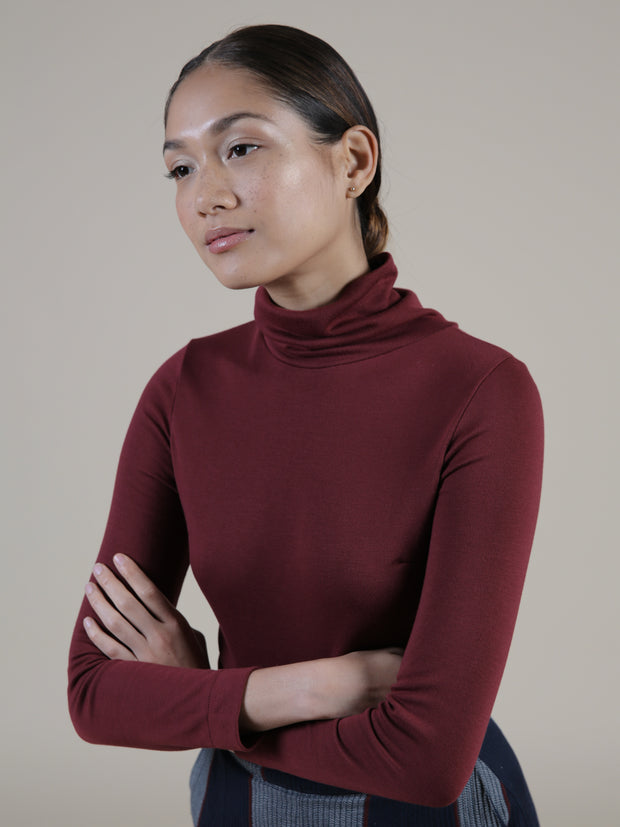Red turtleneck bodysuit