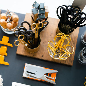 scissors and other desk tools including staplers