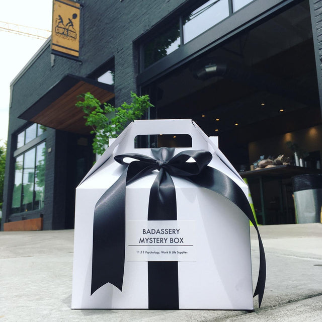 mystery gift box in front of cup and bar