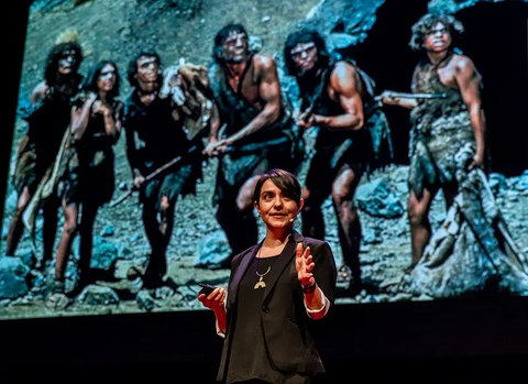 Paloma standing before and image of six neanderthals