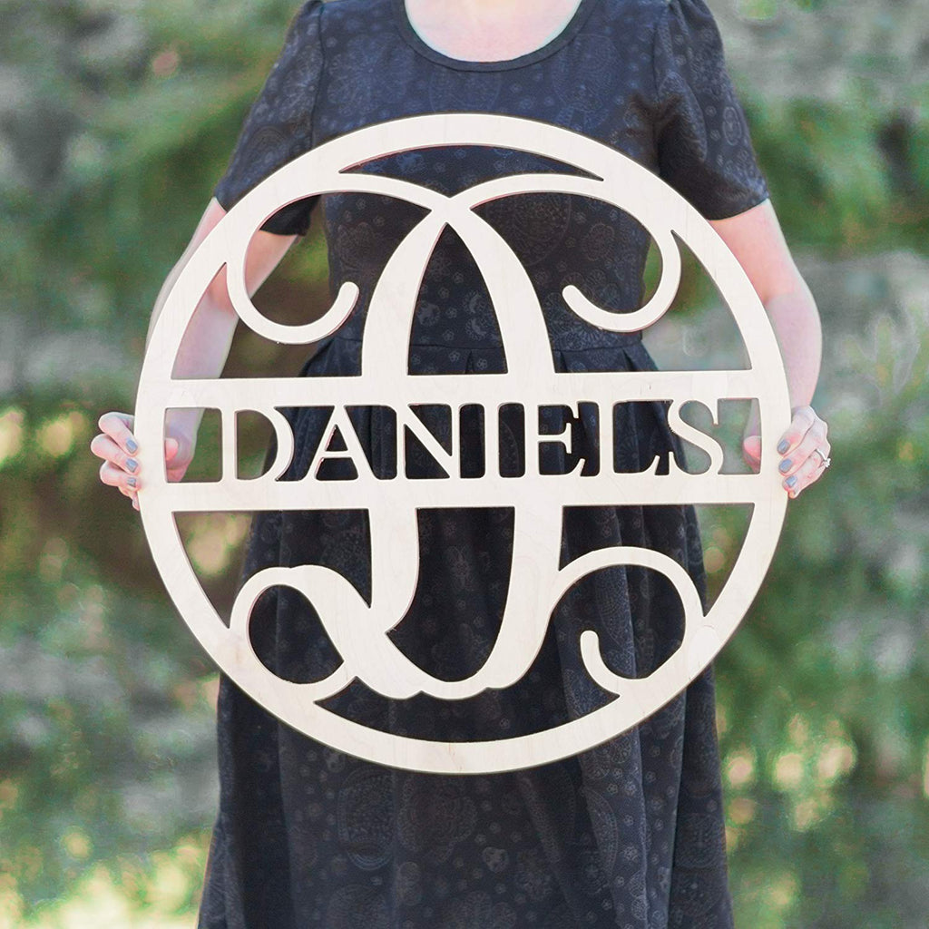 woman holding wooden name sign in a circle