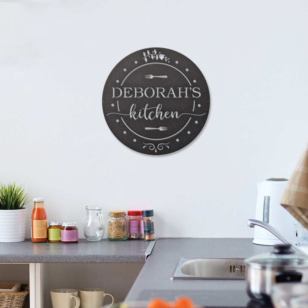 An image of the kitchen circle metal monogram sign from 48 Hour Monogram hanging above a kitchen counter.