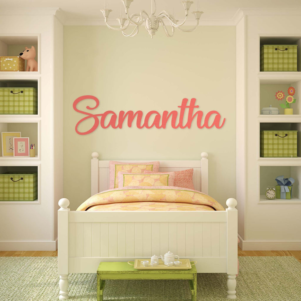 pink wooden monogram sign on bedroom wall