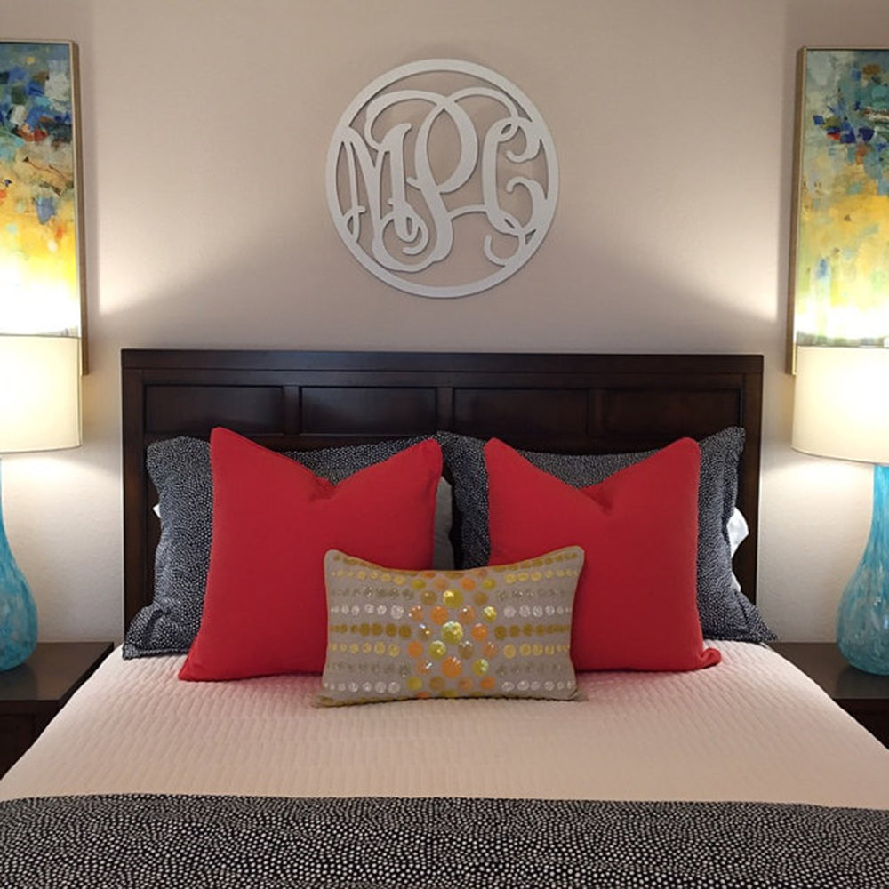 three letter circle monogram sign on bedroom wall