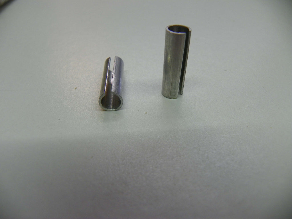 "Rolled aluminum bushing for using 5mm shank bits in a 1/4"" collet."