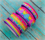 "3/8"" & 7/8"" Glittered Easter Eggs and Doodle Swirls on Bright Rainbow Stripes - 5yd Roll"