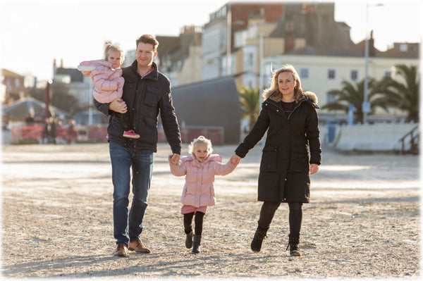 Fountain Rock Founder and family walking on Weymouth beach in Dorset.