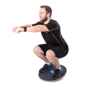 Man Using Woman Using 66fit Wooden Balance Board - PVC Surface - 50cm
