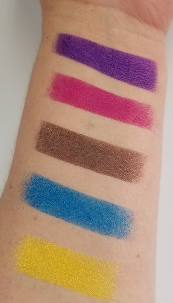 shade beauty, eyeshadow, vegan makeup, cruelty free makeup, swatches, shimmery eyeshadow, sparkly eyeshadow, metallic eyeshadow, neutral eyeshadow, nude eyeshadow, indie makeup, artisan makeup, justice, justice pressed eyeshadow, purple eyeshadow, bright eyeshadow, vibrant eyeshadow
