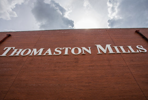 Thomaston Mills Sign on the side of the plant.