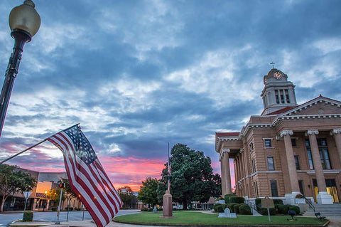 Town of Thomaston Georgia, home of our manufacuting for 115 years, at sunset with American flag.