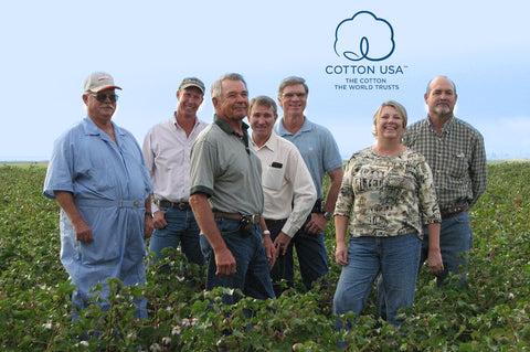 Texas Organic Cotton Marketing Cooperative Farmers with blossoming cotton crops.